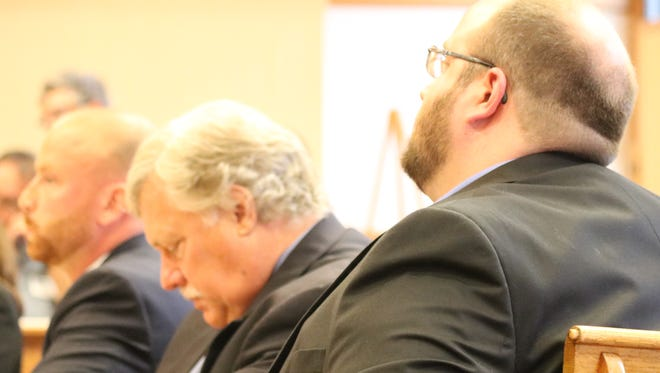 Brad Corbin, right, joined by his attorney's Kevin Zeiher, center, and Kyle Wright, is on trial this week for arson and insurance fraud in Ottawa County Common Pleas Court.