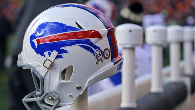 A view of a Buffalo Bills helmet with the Salute to Service logo while sitting on the bench at Paul Brown Stadium.
