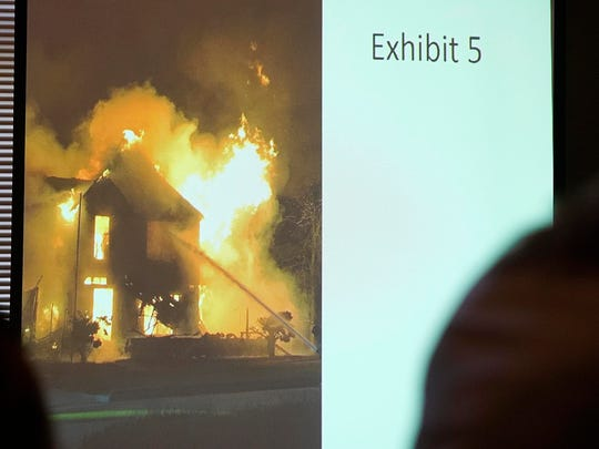 Prosecutors show photographs taken the night Shirley Exline's Guthrie Center home burned in May 2017 during the murder and arson trial of Patrick Thompson on Thursday, Sept. 27, 2018, at the Monroe County Courthouse in Albia.