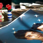 """FILE - In this  Dec. 10, 2014 file photo, Prison artwork created by Adnan Syed sits near family photos in the home of his mother, Shamim Syed, in Baltimore.  Syed, the subject of the popular podcast """"Serial"""" will be allowed to appeal his murder conviction, a Maryland court has ruled.  Adnan Syed, 34, was convicted in 2000 of strangling his ex-girlfriend, Hae Min Lee, the year prior, when both were high school students in suburban Baltimore. """"Serial"""" examined the case in detail and raised questions about Syed's guilt and whether he received a fair trial."""