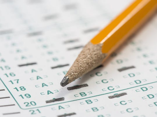 Standardized test answer sheet and pencil