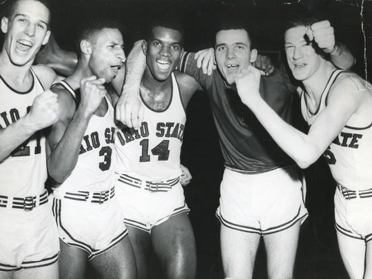 The 1960 Ohio State men's basketball team starting five, from left, Larry Siegfried, Mel Nowell, Joe Roberts, Jerry Lucas and John Havlicek celebrate after winning the national championship.