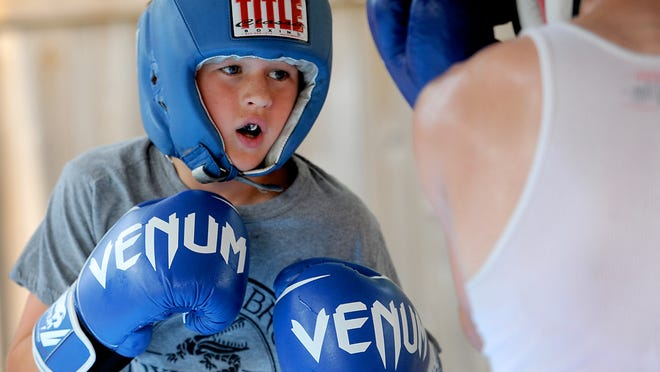 Boxer Toby Brook, a 12-year-old who is part of Dement Brothers Old School Boxing Club, spars during a recent practice session at coach Jake Dement's house in Shreveport.