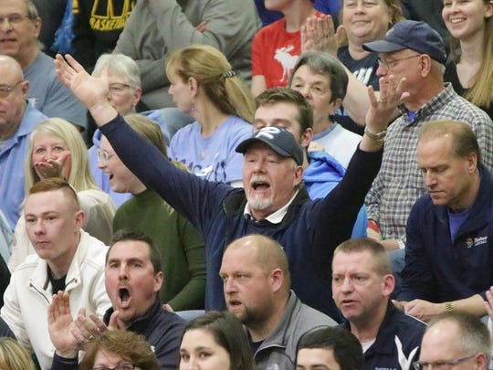A Roncalli fan reacts to a referee decision during the game with The Prairie School, Saturday, March 10, 2018, at Waukesha South in Waukesha, Wis.