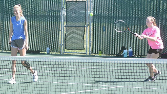 Members of the Newton High School girls tennis team open practice at the Phil Scott Tennis Courts.