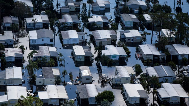 Aerial view of Imperial Bonita Estates, a mobile home park, in Bonita Springs on Saturday, Sept. 16, 2017, six days after Hurricane Irma.  (AP Photo/Naples Daily News, Nicole Raucheisen)