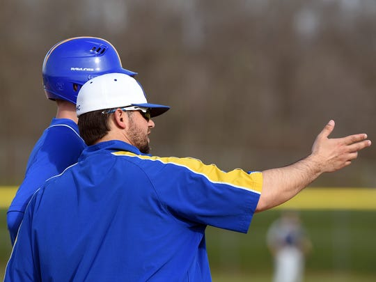 Maysville coach Nathan Prati talks to a player at first in the file photo. Prati was a long-time baseball coach for Maysville High School before taking over Coshocton this season.