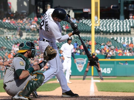 Detroit Tigers' Nicholas Castellanos hits a three-run home run to right field in the seventh inning against the Oakland Athletics, Monday, June 25, 2018, in Detroit.