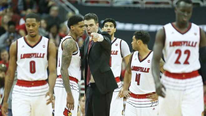 Louisville's Ray Spalding listens to interim coach David Padgett in the second half of the Cards' 71-62 win Saturday, Dec. 9, at the KFC Yum! Center in downtown Louisville. Spalding had 10 points and 14 rebounds with five blocks.