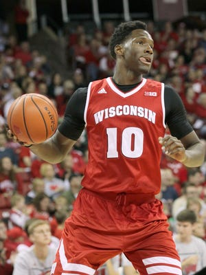 Nigel Hayes protested the lack of pay for students athletes earlier this fall.