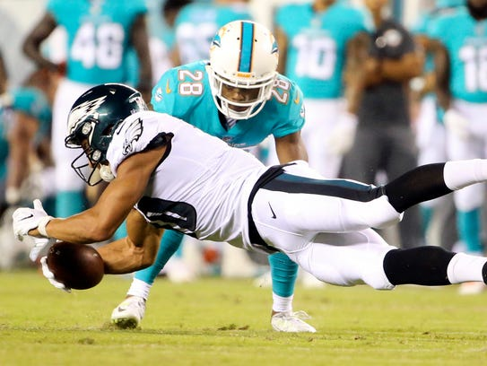 Eagles receiver Mack Hollins stretches for extra ground