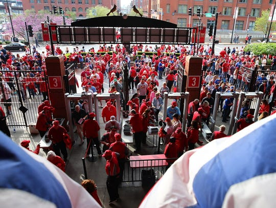 Fans enter Busch Stadium prior to the  Opening Day
