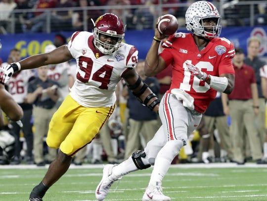 Ohio State quarterback J.T. Barrett (16) is chased