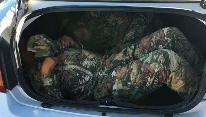 Two illegal immigrants were discovered in the trunk of a vehicle during one failed smuggling attempt on Sunday.