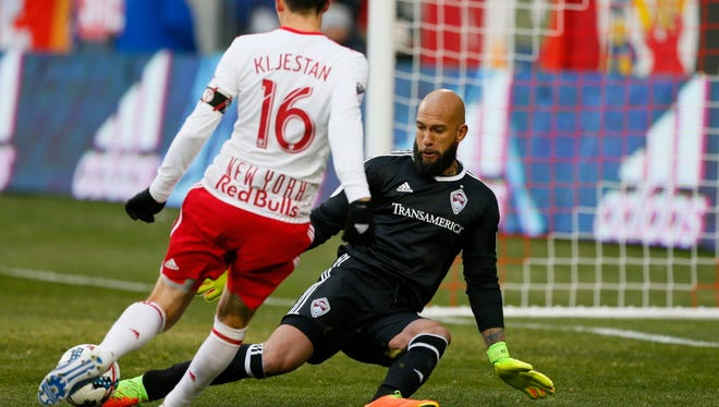 Colorado Rapids goalkeeper Tim Howard stops a shot by New York Red Bulls midfielder Sacha Kljestan during the second half at Red Bull Arena.