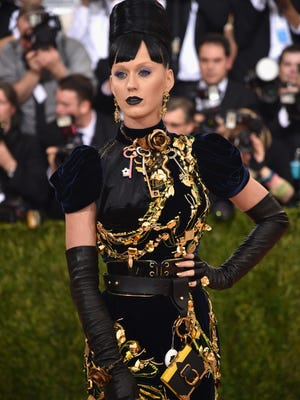 Katy Perry was covered in black, gold and a Tamagotchi at the Met Gala.