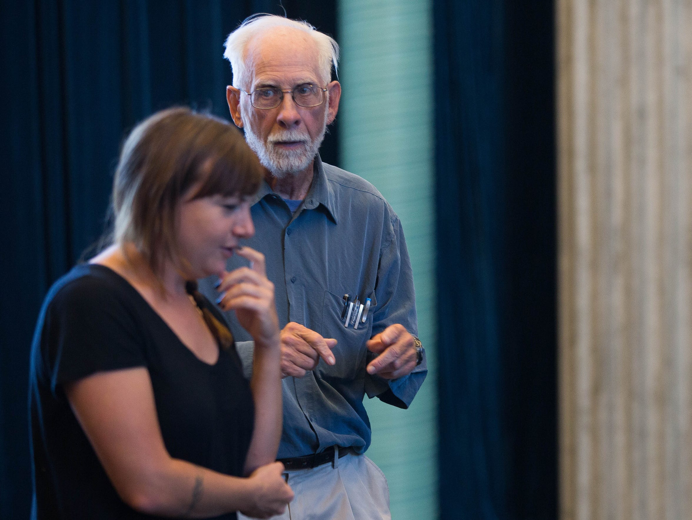 John Hamilton, diagnosed with Parkinson's disease seven years ago, participates in an acting exercise with Meg Brauckmann at the New Mexico State University Performing Arts Center.