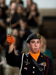 Sgt. 1st Class Cameron Lyons with the JROTC participates in the Parade of Heroes by holding a saber at the South Middle School 37th Annual Veterans Day Program Friday morning.