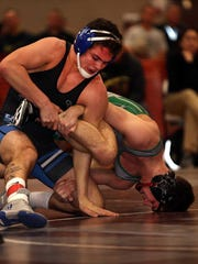 Middlesex's Jeff Johnson (left) wrestles South Plainfield's Joe Sacco in the 145-pound Region 4 final.
