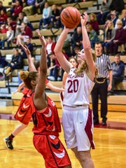 Milford's Allison Smith (20) goes up for the shot against a Grand Blanc defender.