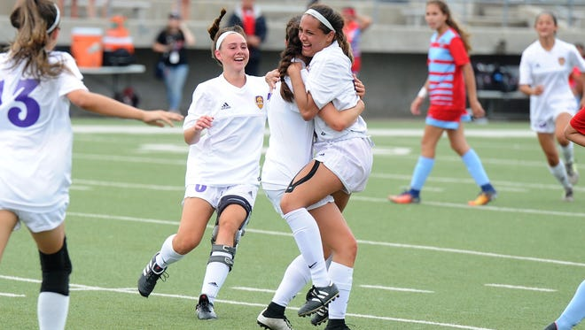 Wylie forward Randie Dennison (10) jumps into the arms of Gracie McCaslin (4) after scoring the first goal for the Lady Bulldogs in the Region I-4A semifinal against Fort Worth Castleberry at the Birdville ISD Fine Arts/Athletics Complex on Friday, April 13, 2018.
