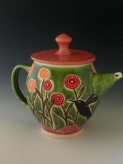 Teapot by Renee Schwaller of Off the Wall Pottery, one of the sites in the Aug. 4 Progressive Art Crawl.