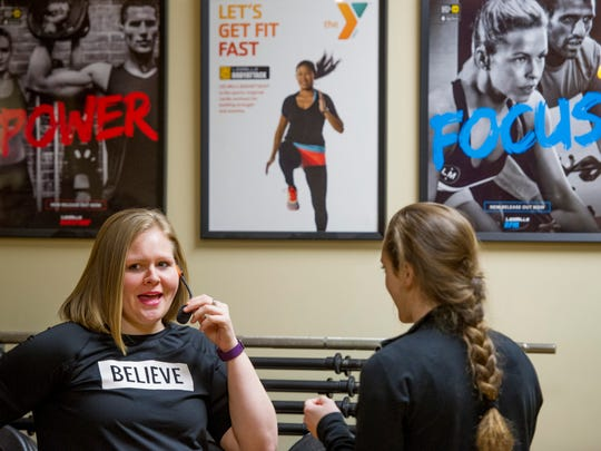 Britni Gates adjusts her wireless microphone before taking the floor to teach Zumba at the Lowell and Helen Dunigan Family YMCA Thursday morning. Besides working her class into a state of dancing delirium, Gates gives back to her YMCA family by sharing her story of exercise, healthy eating and weight loss.