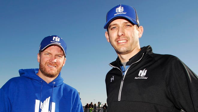 Dale Earnhardt Jr. and new crew chief Greg Ives after practice on Wednesday at Daytona International Speedway.