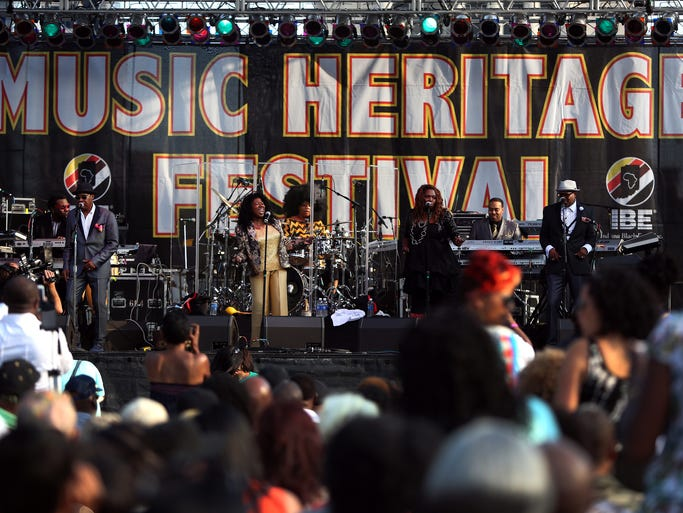 The S.O.S. Band performs during the first night of the Music Heritage Festival on the American Legion Mall in Indianapolis on Friday, July 18, 2014.