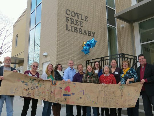 Coyle Free Library, Chambersburg, celebrated its grand re-opening following a $5.5 million renovation and expansion project with a ribbon cutting on Saturday. Participants included, from left, Dana McCartney, Angie Carson, Denice Bigham, Sharon Stottlemyer, Mark Story, Ruth Gembe, Sarah Applegate, Meagan Miller, Lou Cowles, Jill Anne Yaich, Bernice Crouse, and County Commissioner and library board president Dave Keller.
