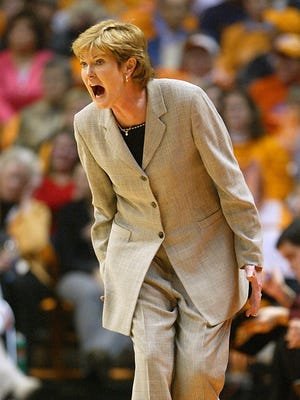 Pat Summitt, seen in this file photo along the sideline coaching the Tennessee Lady Volunteers, died peacefully Tuesday morning at the gae of 64 at Sherrill Hill Senior Living in Knoxville surrounded by those who loved her most, according to her son, Tyler.