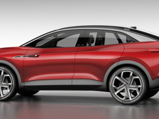 The I.D. Crozz II, a sporty red SUV with a curved roof and large wheels, shown from the side.