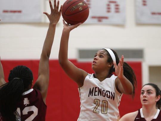 Mendon's Lexi Green (20) shoots over Aquinas'  Nia
