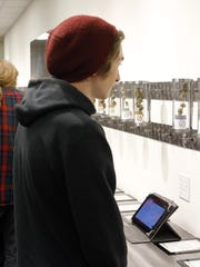 Customers look at product displays at Shango Premium Cannabis, in Portland , Ore., Thursday, Oct. 1, 2015.