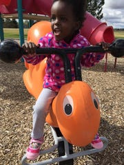 Amara Ochsner enjoys the awesome playground equipment at Russell Park.