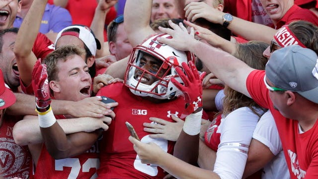 Wisconsin cornerback Sojourn Shelton celebrates the win against LSU by diving into the student section at Lambeau Field last season.