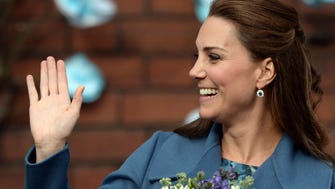 Duchess Kate waves after a visit to a pottery factory in Stoke-on-Trent on Feb. 18.