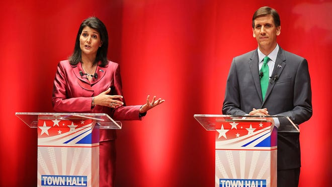 South Carolina Republican Gov. Nikki Haley faces Democratic Sen. Vincent Sheheen and other gubernatorial candidates in a televised debate at Charleston Southern University, in Charleston, S.C., Tuesday, Oct. 14, 2014. (AP Photo/The Post And Courier, Wade Spees)