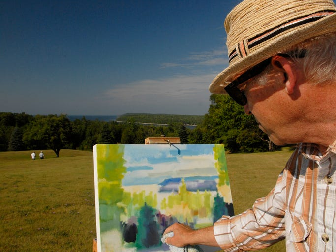 Plein air artist Rob Williams of Ellison Bay paints from on top of the Ellison Bay bluff at Grand View Scenic Overlook and Park, 11871 State 42, Ellison Bay, the site of the 16th annual Door County Land Trust's Gathering on Sunday, Aug. 24, 2014. About 400 people attended the annual members gathering for a picnic of food, music and games. Some of the photos appeared in the Aug. 27 edition of Your Key to the Door Weekly. Tina M. Gohr/Your Key to the Door Weekly