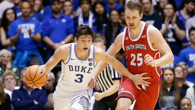 Duke's Grayson Allen (3) dribbles the ball against South Dakota's Tyler Hagedorn (25) during the first half of an NCAA college basketball game in Durham, N.C., Saturday, Dec. 2, 2017.