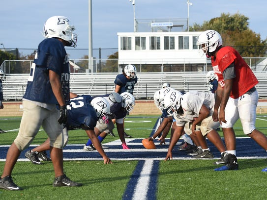 Poughkeepsie High School's football team lines up to