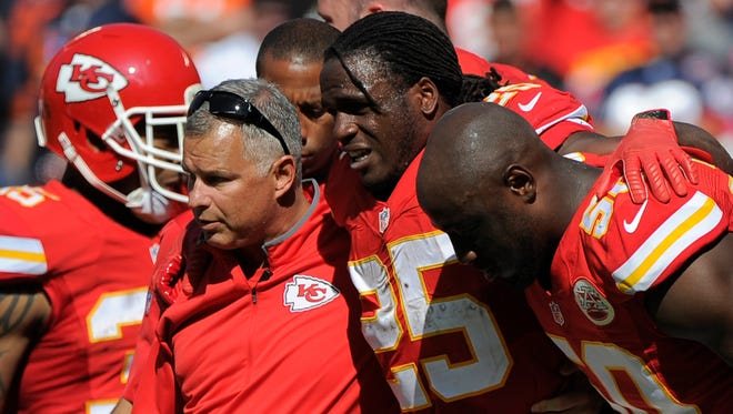 Kansas City Chiefs running back Jamaal Charles (25) is helped off the field after an injury in the second half of an NFL football game against the Chicago Bears in Kansas City, Mo., Sunday, Oct. 11, 2015.