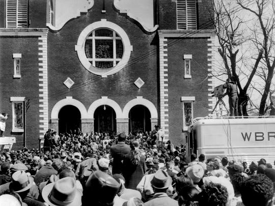 Civil rights demonstrators, led by Rev. Martin Luther King Jr. (not pictured), arrive in front of the Brown Chapel AME Church in Montgomery from Selma on March 26, 1965, in Alabama, on the third leg of the Selma-to-Montgomery marches.