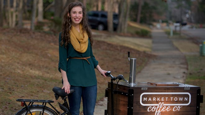 Laura Jean Bell shows off her new coffee cart in Montgomery, Ala., on Thursday February 2, 2017. Her previous Market Town Coffee Company cart was stolen and the replacement was purchased with money raised on a GoFundMe account.