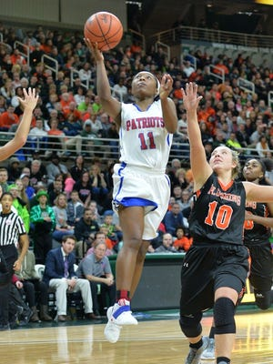 Warren Cousino sophomore Mackenzie Cook goes up for a shot against Flushing's Shelby Morrow in Friday's Class A semifinal in East Lansing. Flushing won, 52-36, to earn a spot in Saturday's state final.