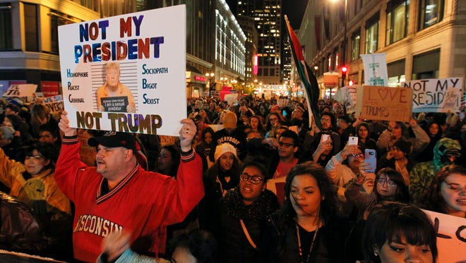 Anti-Trump protesters march on Wisconsin Ave. in Milwaukee Thursday Nov. 10.