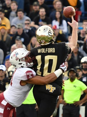 Temple Owls linebacker Jarred Alwan (41) hits Wake Forest Demon Deacons quarterback John Wolford (10) as he throws during the first quarter at Navy-Marine Corps.