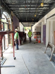 Construction crews work at a steady pace in the revamped