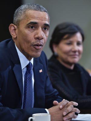 President Obama speaks following a meeting with his economic team in the Roosevelt Room of the White House Friday. At right is Commerce Secretary Penny Pritzker.