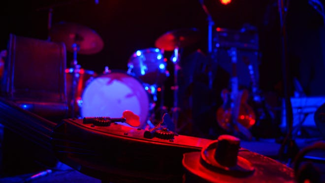 Sugar Thieve's stand up bass rests on the stage at Last Exit Live for the one year anniversary show.